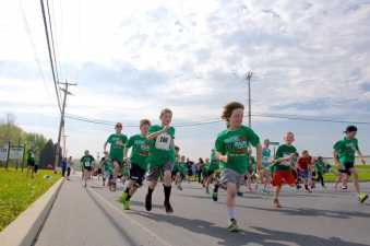 children running in a charity race