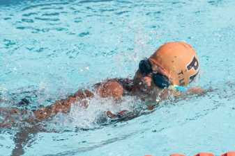 a child swimming at a swim meet