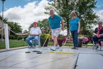 playing shuffleboard at a retirment community