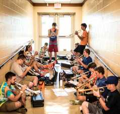 high school band practice in a hallway