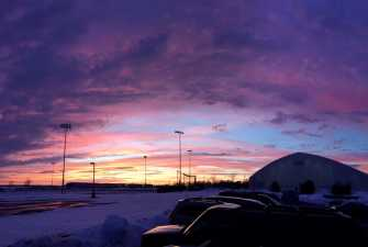 looking over a parking lot in the winter at dusk