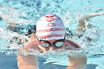 a boy in a swimming cap