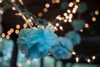 blue faux flowers hung with lights